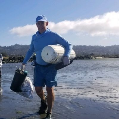 picking up trash from the river