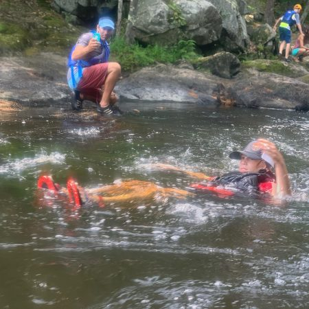 Person floating down the Lamprey River