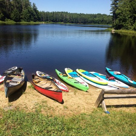 Canoes and Paddleboards ready to float the river