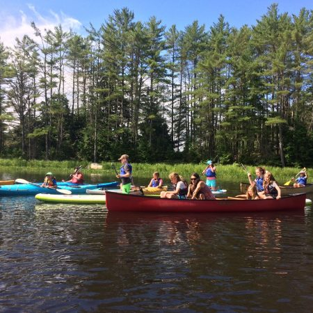 Canoers, paddleboarders and kayakers on the Lamprey River