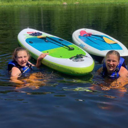 Paddleboarders enjoying the refreshing river