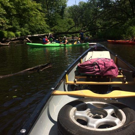 Cleaning up trash out of the Lamprey River