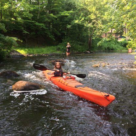 cruising a kayak through some rocks
