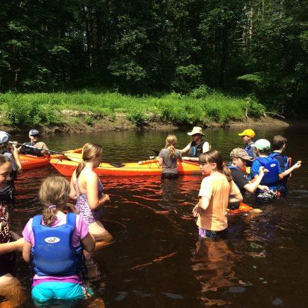group of kayakers enjoying the river