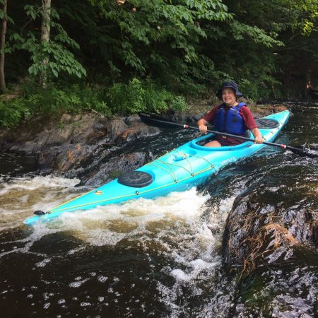 kayaker sending it over a mini waterfall
