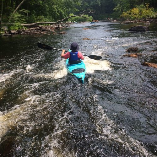 kayaking through small rapids