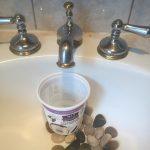 Yogurt container in sink