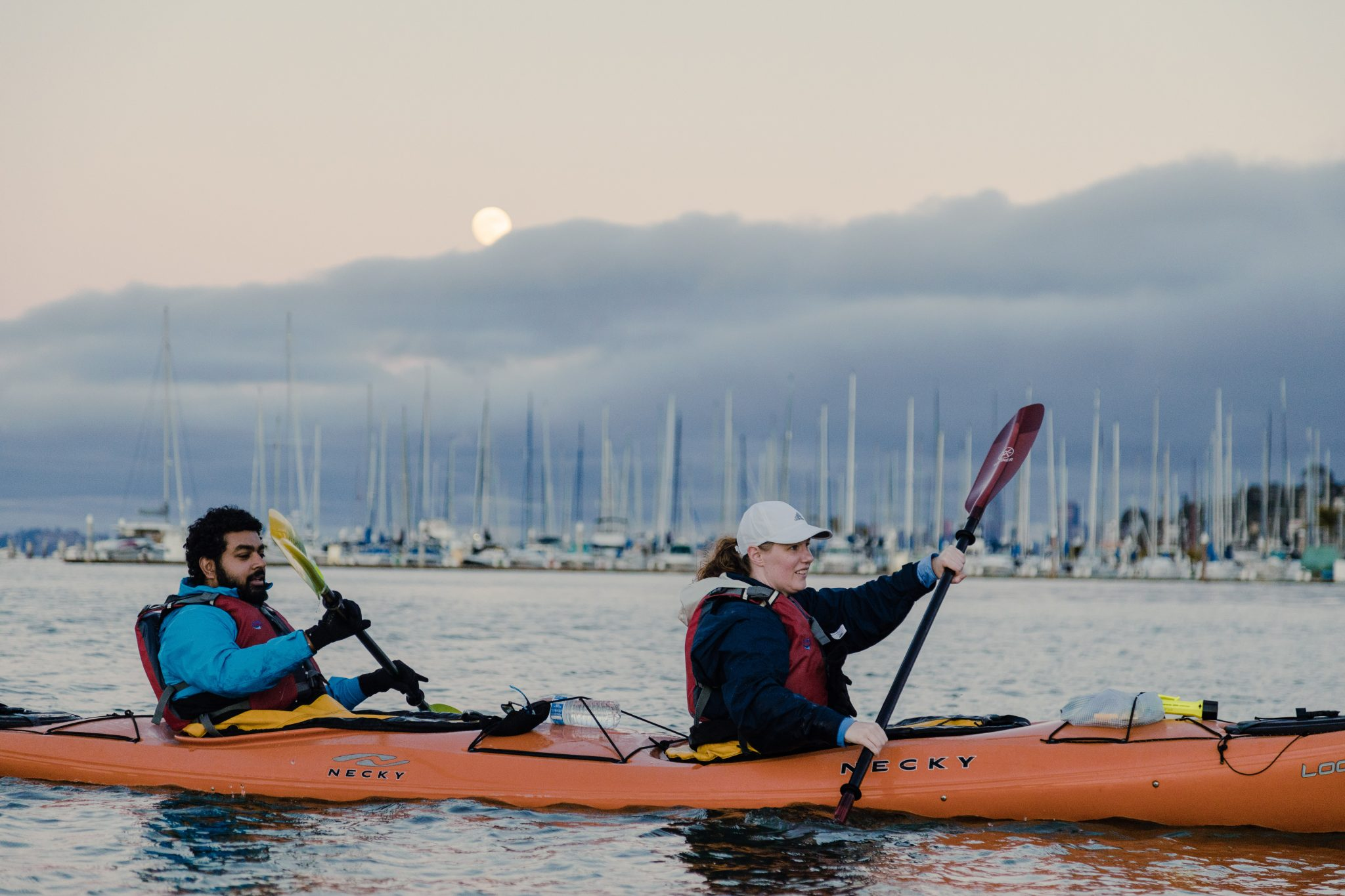 2 kayakers under the full moon